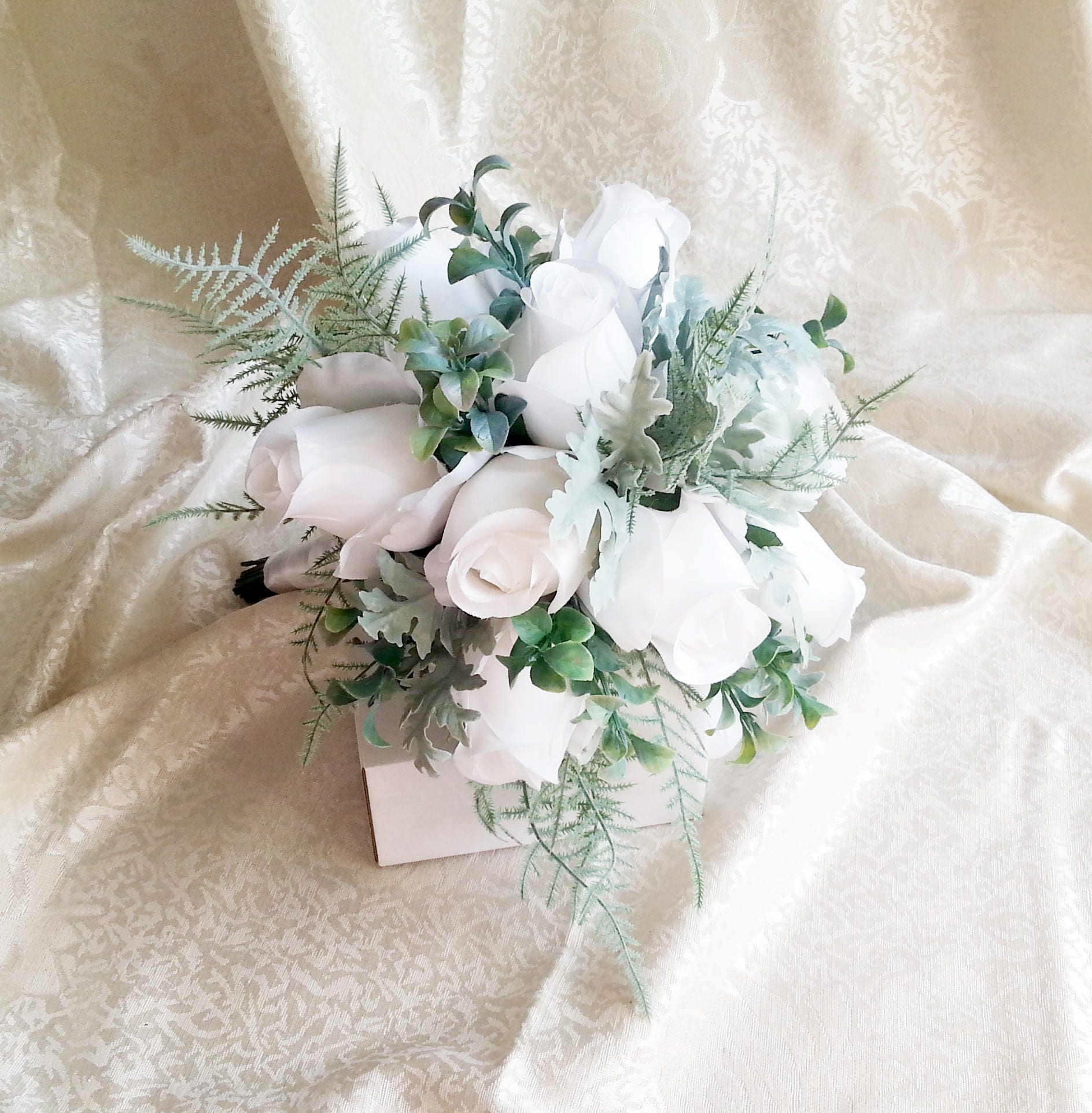 White roses dusty miller wedding bouquet frosted greenery fern ...