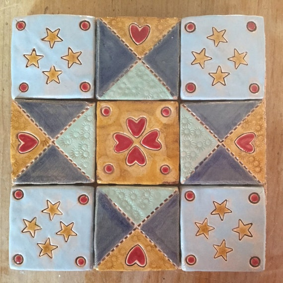 Handmade ceramic tiled potstand, patchwork theme, eyecatchingly pretty, countrystyle