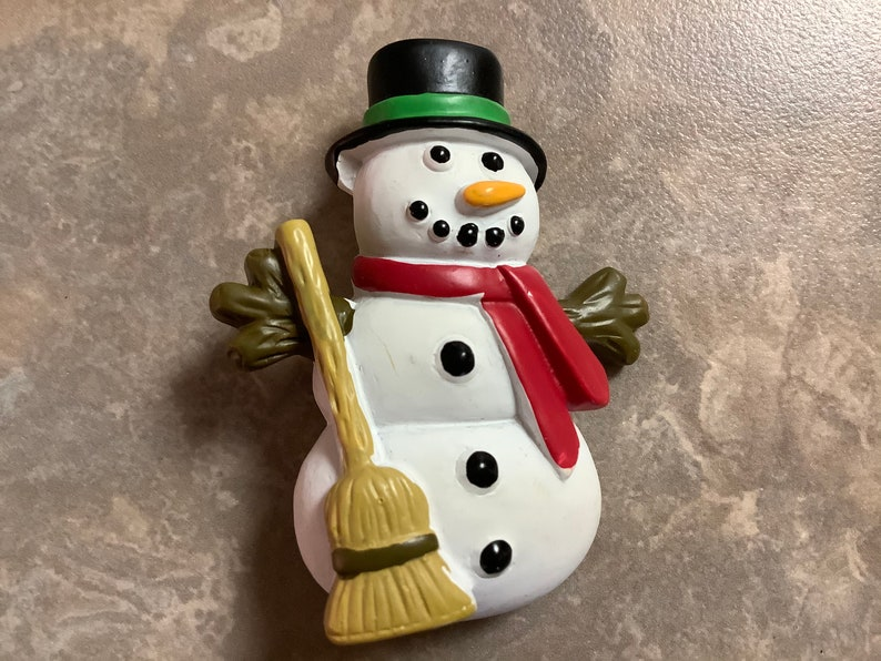A Snowman Brooch with Pin.
