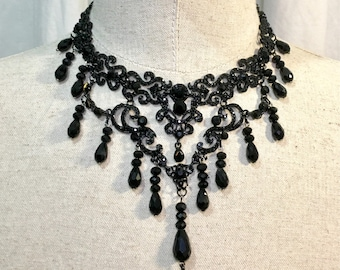 Handmade necklace black decorations and glass beads