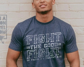 Fight the Good Fight of Faith Adult Unisex Mission Sustainable Fair Trade T-Shirt   Fight the Good Fight TShirt   Christian T Shirts for Men