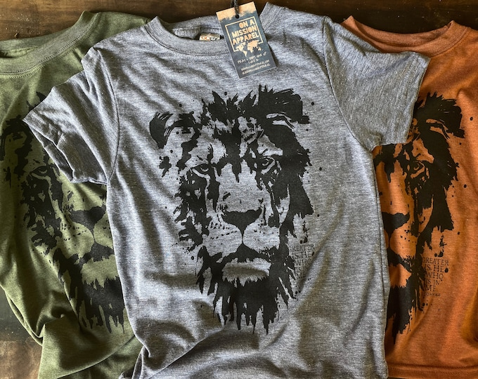 Featured listing image: Greater is He Lion of Judah Fair Trade Sustainable Eco-Friendly Youth Triblend T-shirt