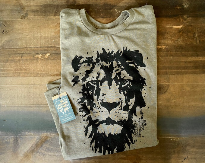 Featured listing image: Greater is He Adult Unisex Sustainable Fair Trade Triblend Mission T Shirt | Lion of Judah T Shirt | Christian T Shirts for Men