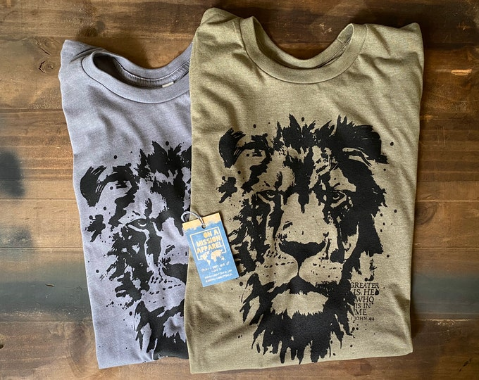 Featured listing image: Greater is He Adult Unisex Sustainable Fair Trade Triblend Mission T Shirt   Lion of Judah T Shirt   Christian T Shirts for Men and Women