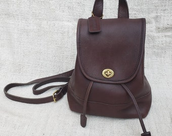 Vintage Coach Brown Leather Mini Backpack Daypack Rucksack Bag Purse  Classic Minimal Brass Turn lock Buckles hangtag serial 9960 made in USA 43569580324e8