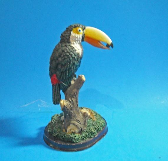 Toco Toucan on tree figurine