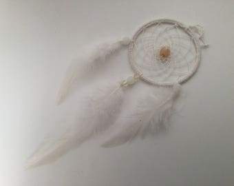 Beautiful dream catcher with white glass beads