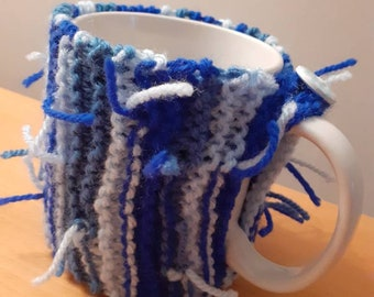 Hand knitted mug cosy in a garter stitch design suitable for a small/medium mug