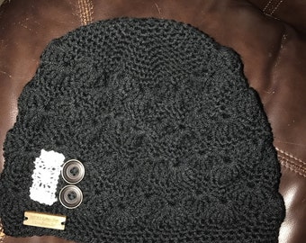 Crocheted lace beanie with buttons