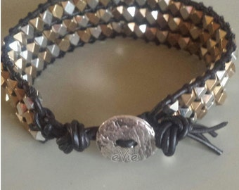 Beaded metal and leather bracelet with rustic clasp