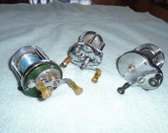 Vintage fishing reels. 3 fishing reels. Bait casting reels. vintage fishing tackle. Reel. Fishing reel