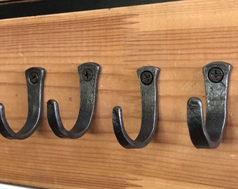 Small hooks, set of four and hand forged in America.