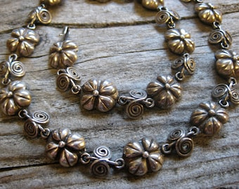 ca. 1950-60 signed TAXCO sterling choker necklace, 15 3/4 inches long. Artisan hand crafted flower & spiral vine, cosmic swirl.