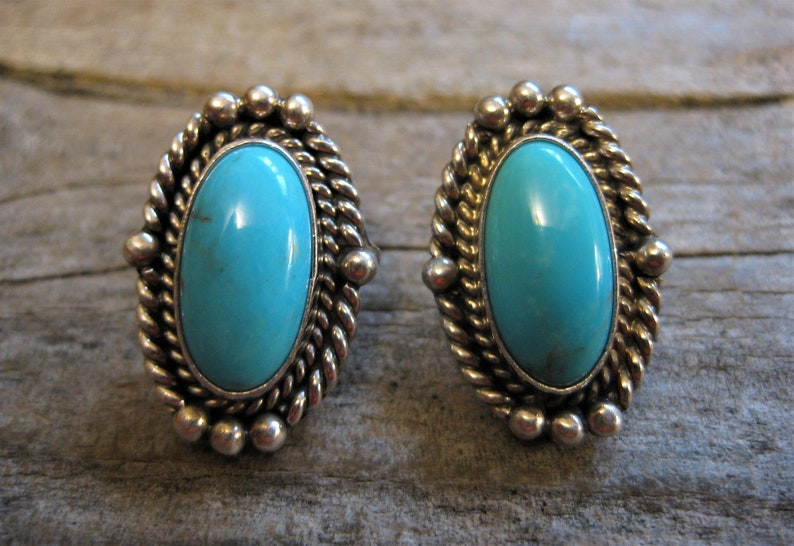 Southwestern chic. beautiful detailed silver work signed sterling SLEEPING BEAUTY turquoise 1 oval stud EARRINGS Navajo artisan crafted