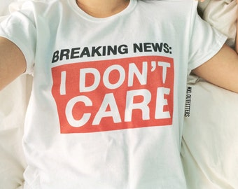Breaking News: I Don't Care T-shirt © Design by Euclea Tan