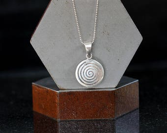 Hypnotic pendant etsy sterling silver hypnotic swirl pendant necklace mozeypictures Choice Image