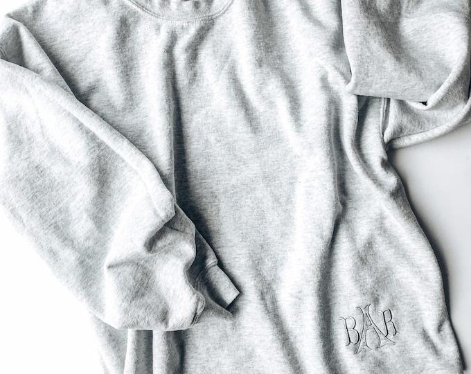 Women's monogram crew neck sweatshirt with raw edge hem line
