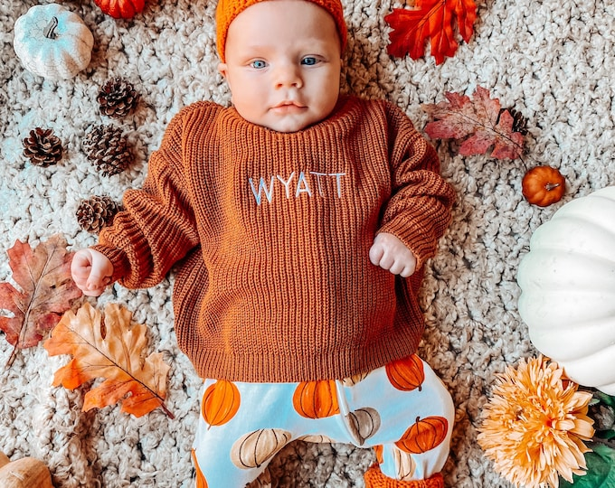 Personalized baby sweater with embroidered name available in infant and toddler sizes