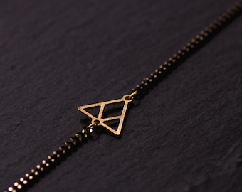 Triangle bracelet is gold & Black