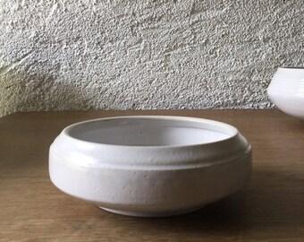Ceramic salad. Fruit cut. Service dish. White dishes. Flat sandstone. Hollow plate. Ceramics, decoration, crockery, gift.