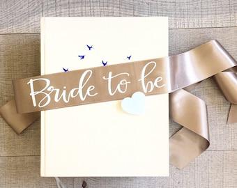 Bride to be sash, Custom bachelorette sash, Beige white sash, Bachelorette sash with white heart pin, Classy hen sash, Gift for bride to be