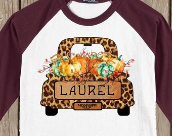 LAUREL Autumn Thanksgiving Raglan 3/4 sleeve style T shirt - Fall cheetah print truck filled with Pumpkins with the words Laurel Mississippi