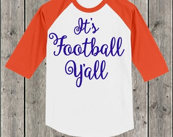 It's Football Y'all T shirt 3/4 sleeve baseball style raglan.  Your choice of sleeve color and print color.  Football T Shirt Raglan.