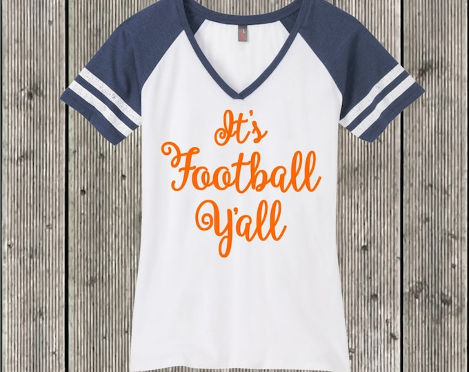 It's Football Y'all T shirt District Women's Game V Neck T.  Your choice of sleeve color and print color.  Football T Shirt Raglan.