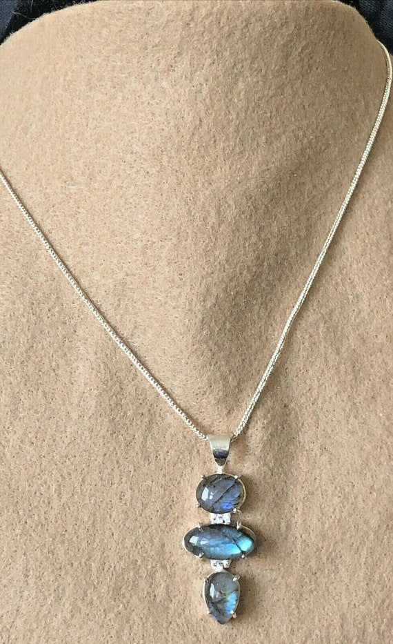 Labradorite pendant on a triple strand semi precious gemstone sterling silver necklace