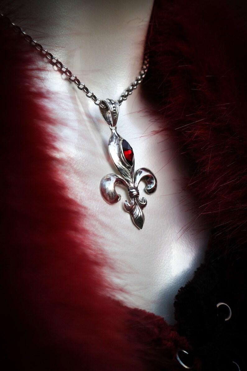 Fleur-de-lis pendantsterling silver with garnet