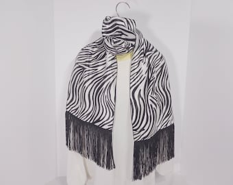 Scarf Beautiful Fashion Scarfs will add a splash of color to an outfit worn at the neckline, as a headband, turban, as a sash around waist: