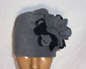 Hats fleece with bold unique flower accentuates one side, perfect winter hat worn with sweaters, jackets. Solid, Animal Print, Variety