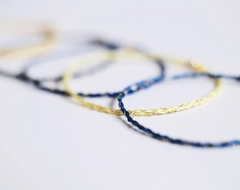 9ct gold and silk skinny bracelets