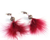 Earrings made with pink p...