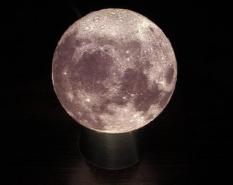 """Moon Lithophane Lamp/Nightlight. 3"""" Diameter Moon on Silver Base with replaceable LED light bulb, on-off switch on cord, 120v."""