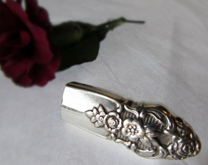 Lapel vase. Lapel pin created from a vintage  silver plate knife handle. Vintage Wedding boutieneer vase.