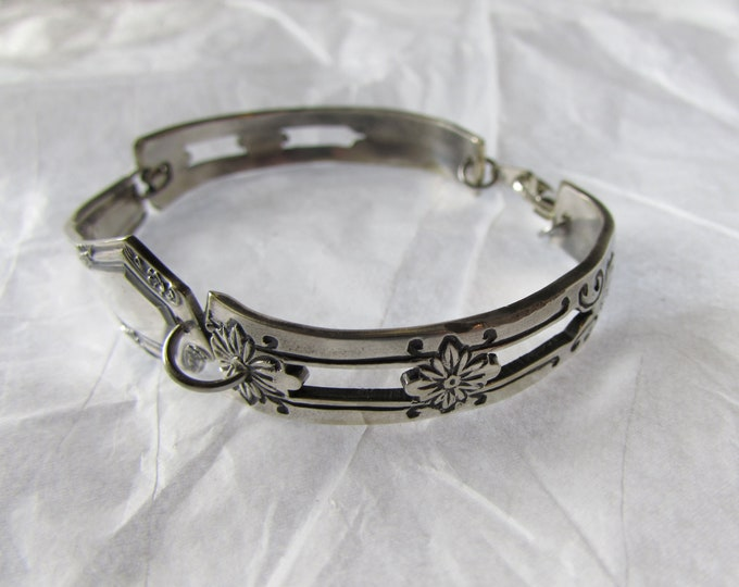 Silverware bracelet. Created using antique silverplate pieces.