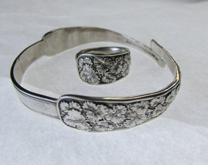 Sugar tong cuff with matching spoon ring. Original recycled antique pieces.