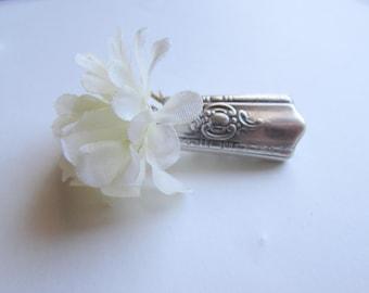 Lapel vase. Lapel pin created from a vintage  silver plate knife handle. Vintage Wedding boutieneer vase.