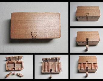 Ring Bearer Box. Puzzle box style wedding ring box made from a solid piece of Cherry wood.