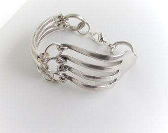 Fork bracelet.fork bangle.Made with Antique pieces of silver plate silverware, 3 handles  and curled fork tines