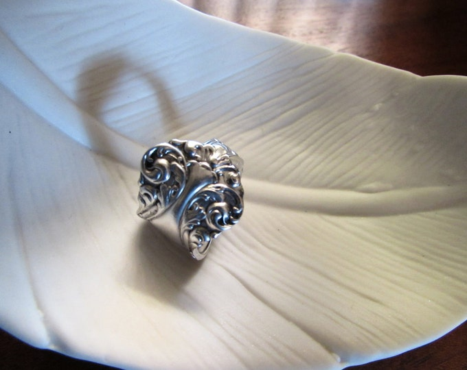Spoon ring. Spoon ring made from a petite baroque pattern silver spoon.    Size's 5-15.