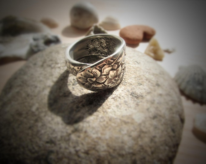 Spoon ring. Daffodil flowers inside and out. Symbolizing rebirth and new beginnings.