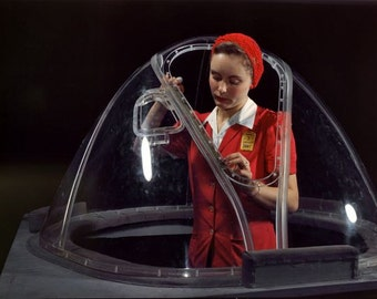 Aircraft factory worker assembling part of Flying Fortress bomber reproduction of vintage photograph 1942 by Alfred T Palmer for OWI