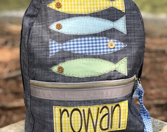 f517ee7ef2c5 4 fish applique backpack