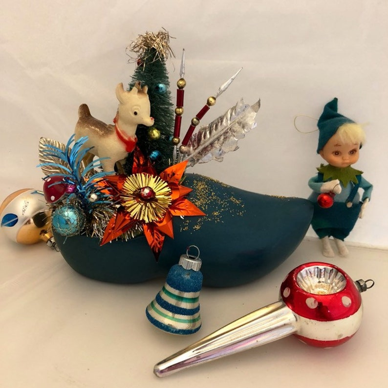 Christmas Arrangement Ensemble Grouping In Teal And Red Using Vintage Elements Deer Bottle Brush Tree Mercury Glass Baubles In Wooden Shoe