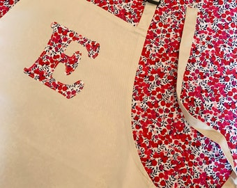 Personalised Liberty of London Initial Apron for Children, available in a range of Christmas fabrics