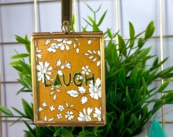 Small Liberty Print Laugh Framed Cut Out, available in a range of fabrics