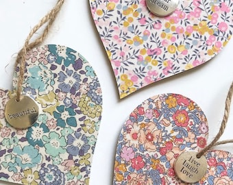Liberty of London Wooden Hanging Heart. Handmade and Available in Various Tana Lawn Fabrics. Featuring a Pendant in a quote of your choice