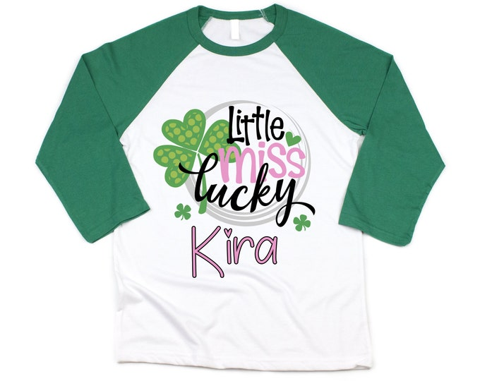 Little Lucky Charm Girl St. Patricks Shirt Saint Patricks Day Shirt Personalized Girl Clover Shamrock Shirt Pink Green Green Raglan Bodysuit